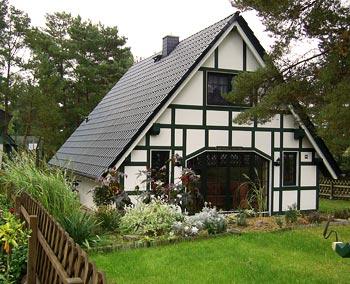 Landhausstil haus bauen landhaus for Fachwerkhaus bauen